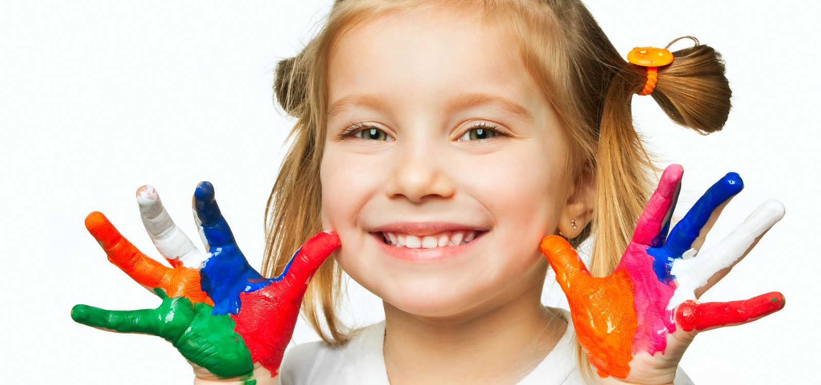 Cute preschooler with finger paint on hands