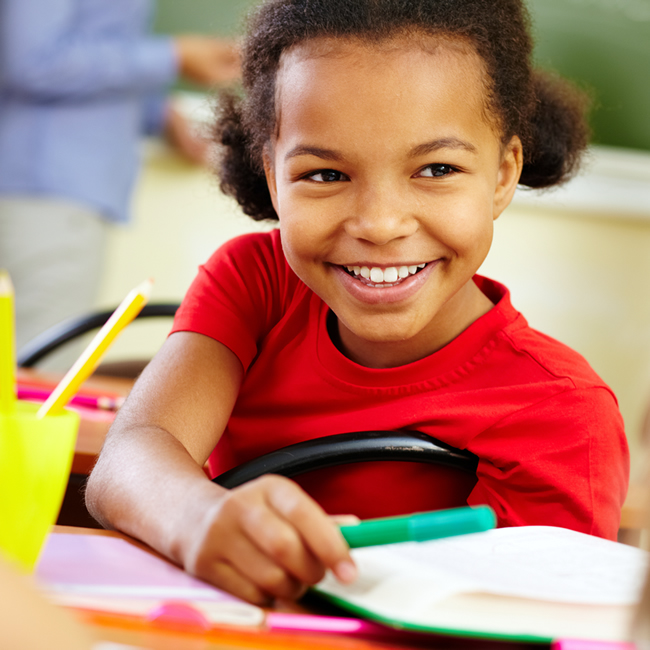 Kindergartener sharing a pencil