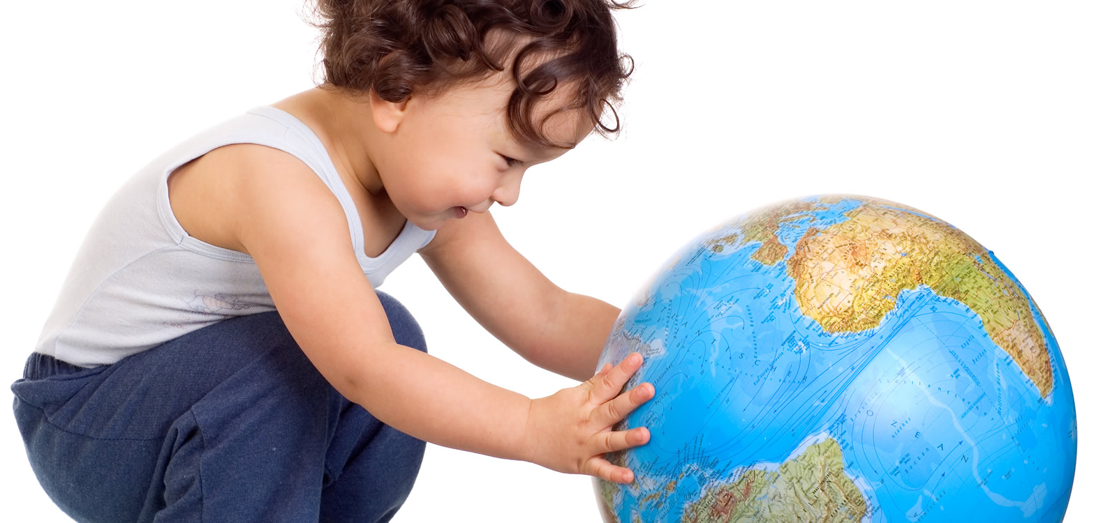 toddler playing with globe