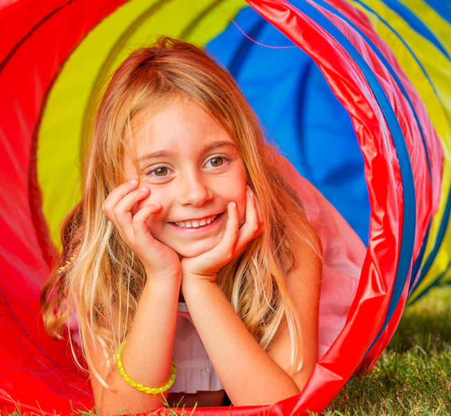 young girl having fun in playground